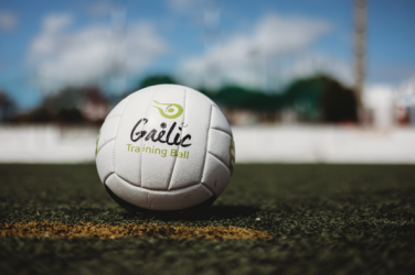 How does Gaelic Football differ from Association football and Rugby?