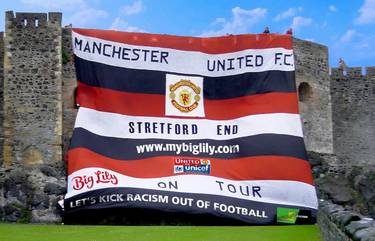 MANCHESTER UNITED'S BIG LILY FLAG FEATURES IN NEW BELFAST PEACE WALL MURAL AND DOCUMENTARY